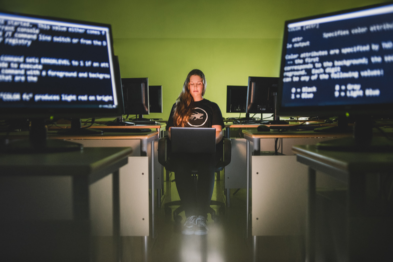 A photo of a programmer working on a computer.