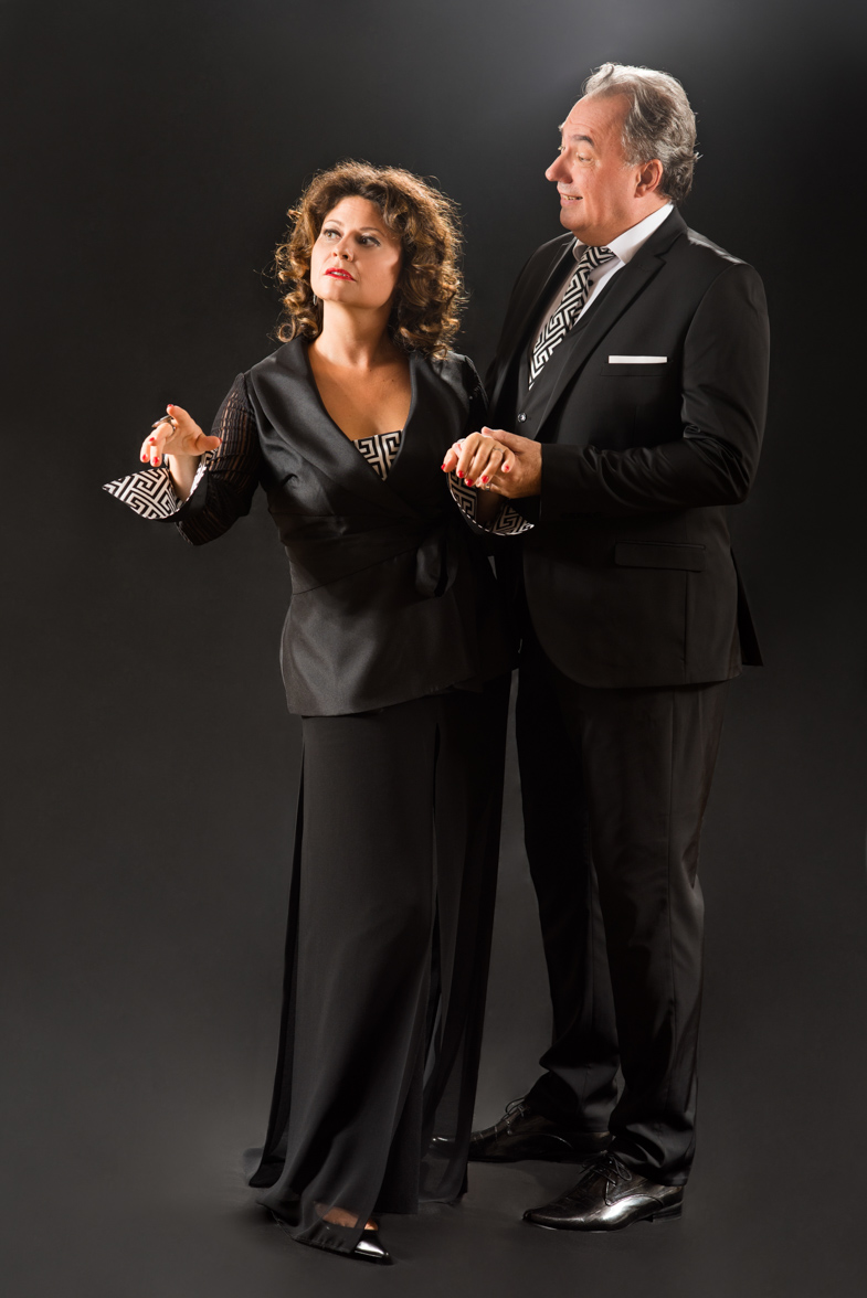 Promotional photography of two actors.